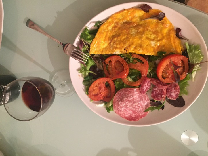 omelet, salad, cooked tomatoes, salami