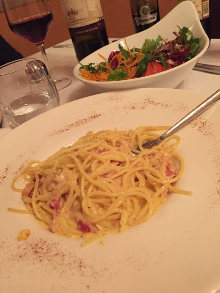 one of our meals .this one in the restaurant ART - pasta and salad and wine..Traditional italian food